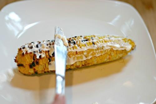 spread mayonnaise on Elote